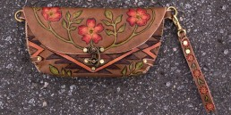 Cow skull clutch with navajo designs & wild roses, carved leather by Joren Eulalee Front View