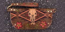 Cow skull clutch with navajo designs & wild roses, carved leather by Joren Eulalee Back View