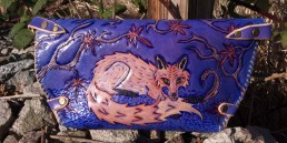 Fox clutch hunting pheasants in the fall, carved leather by Joren Eulalee Back