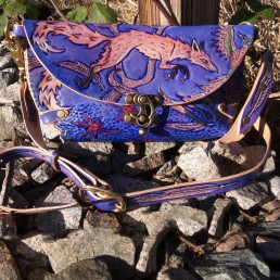 Fox clutch hunting pheasants in the fall, carved leather by Joren Eulalee Front